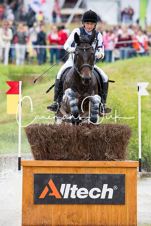 Alena Tseliapushkina, (BLR), Passat - Eventing Cross Country test- Alltech FEI World Equestrian Games™ 2014 - Normandy, France.<br /> © Hippo Foto Team - Leanjo de Koster<br /> 30/08/14