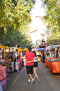Couple walk arm in arm at street market, San Telmo District, Buenos Aires, Argentina, South America