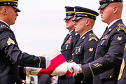 29 AUGUST 2020 - RUNNELLS, IOWA: The Iowa Army National Guard Honor Guard folds the American flag at the funeral for Pvt. Roy Brown Jr. in Runnells, IA. Pvt. Brown was a US Army soldier in World War II. He was an infantryman in the 126th Infantry Regiment, 32nd Infantry Division, serving in the Australian Territory of Papua (now Papua New Guinea). He went missing in action on Dec. 2, 1942. Unidentified remains were recovered on Feb. 2, 1943 and were eventually interred in the Manila American Cemetery. On May 14, 2019, Defense POW/MIA Accounting Agency using dental records, circumstantial evidence and DNA identified the remains as Pvt. Brown's. He was reinterred in the Lowman Cemetery in Runnells Saturday.      PHOTO BY JACK KURTZ