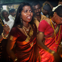 """An argument errupts in the heat and humidity of Koovagam temple as an Aravani is """"married"""" to Lord Krishna's...India's transexual community has a recorded history of more than four thousand years. Many consider the The Third Sex, also known as Aravanis, to posses special powers allowing them to determine the fate of others. As such, they are not only revered but despised and feared too. Resigned to the fringes of society, segregated and excluded from most occupations, many Aravanis are forced to turn to begging and sex work in order to earn a living. ..The annual transgender festival in the village of Koovagam, near Vilappuram, offers an escape from this often desolate existence. For some, the week-long partying and frenetic sex trade that culminates in the Koovagam festival is about fulfilling lustful desires. For others, the gathering provides a chance for transgenders to bond, share experiences, join the wider homosexual gay-community and coordinate their campaign for recognition and tackle the challenge of HIV/AIDS. ..It is the Indian state of Tamil Nadu that the eighty-thousand-strong Aravani community has made advances in their fight for rights. In 2009, the Tamil Nadu state government began providing sex-change surgery free of cost. The state has also offers special third-gender ration cards, passports and reserved seats in colleges. And 2008 the launch of Ippudikku Rose, a Tamil talk-show fronted by India's first transgender TV-host and the release of a mainstream Tamil film staring an Aravani in the lead-role. ..These advances clearly signal a victory for south India's transgenders, but they have also exposed deep divisions within the community. There is a very real gulf that separates the majority poor from their potentially influential but often reticent, upper-class sisters. ..Photo: Tom Pietrasik.Vilappuram District, Tamil Nadu. India.May 2009"""