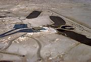 Oil industry infrastructure development Dhahran, Saudi Arabia, golf course being built in desert, 1979