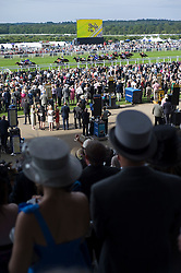 © licensed to London News Pictures. 14/06/2011. Ascot, UK.  Punters watch the last race of the day on day one at Royal Ascot races today (14/03/2011). The 5 day showcase event,  one of the highlights of the racing calendar is in it's 300th year. Horse racing has been held at the famous Berkshire course since 1711 and tradition is a hallmark of the meeting. Top hats and tails remain compulsory in parts of the course. Photo credit should read: Ben Cawthra/LNP