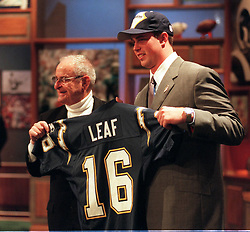 (Published 12/28/2003, C-14, UTS1780187) Ryan Leaf (right) holds up a Chargers jersey with team owner Alex Spanos after being drafted by the Chargers 4/18/1998