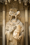 Sculpture of headless man at Cathedral of Notre-Dame in Reims, France
