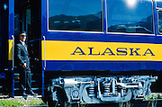 Alaska Railroad conductor, Kam Draper, readies his train for passengers.