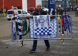 Volunteers help to relocate the tributes left for the victims of the Helicopter crash at the King Power Stadium, Leicester.