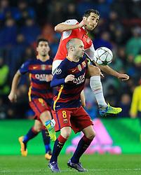 Andres Iniesta of Barcelona challenges Mathieu Flamini of Arsenal - Mandatory byline: Matt McNulty/JMP - 16/03/2016 - FOOTBALL - Nou Camp - Barcelona,  - FC Barcelona v Arsenal - Champions League - Round of 16