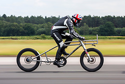 © Licensed to London News Pictures. 12/07/2018. Harrogate UK. File picture taken 18/06/2018 of Neil Campbell on his bike at Elvington airfield. Neil Campbell has today announced that he will attempt to break the world cycling speed record of 166.9mph. Neil set a new European cycling speed record of 135mph last month at Elvington airfield in Yorkshire. The announcement was made this morning at the Great Yorkshire show in Harrogate. Photo credit: Andrew McCaren/LNP