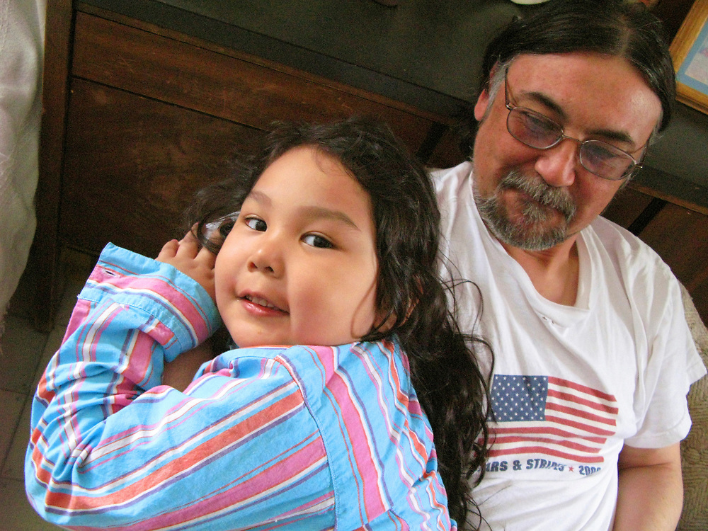 Alaska, Barrow. Hopson family at home. The Iñupiat girl Emeryn Hopson with her grandfather Chuck Hopson. (Model Release)