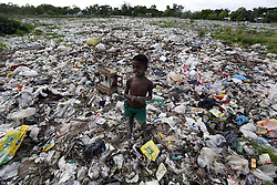 60129657  <br /> A child stands on a garbage dumping ground on the outskirts of Yangon, Myanmar.<br /> Monday, 15th July 2013<br /> Picture by imago / i-Images<br /> UK ONLY