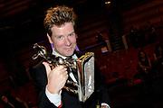 NFF - Nederlands Filmfestival - uitreiking van de Gouden Kalveren in Tivolli Utrecht.<br /> <br /> op de foto:  Pieter Kuijpers van productiebedrijf Pupkin Film met de Gouden Kalf voor de Beste Film voor de film Aanmodderfakker