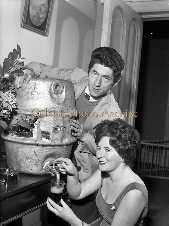 """20/09/1960<br /> 09/20/1960<br /> 20 September 1960<br /> Actors Ann O'Dwyer and Charles Roberts. Ann O'Dwyer who starred in Late Night Review at the Pike Theatre and Husband Charles Roberts, who played  the lead in """"The Scatterin"""" draw a Guinness  at their home in Monkstown, Dublin to celebrate the success of both shows."""