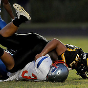 Pender's Sam Dixon is tackled by a Topsail High School Player Friday August 30, 2013 at Topsail High School. (Jason A. Frizzelle) This collection of images is from the 2013 High School Football in the Cape Fear region.