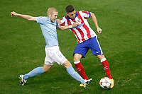 Atletico de Madrid´s Siqueira (R) and Malmo´s Tinneholm during Champions League soccer match between Atletico de Madrid and Malmo at Vicente Calderon stadium in Madrid, Spain. October 22, 2014. (ALTERPHOTOS/Victor Blanco)