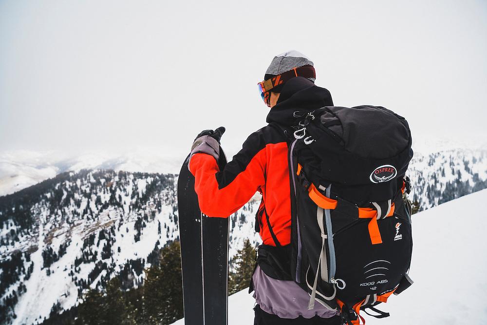 Splitboarder Maxwell Morrill scopes the down, Wasatch Range, Utah.
