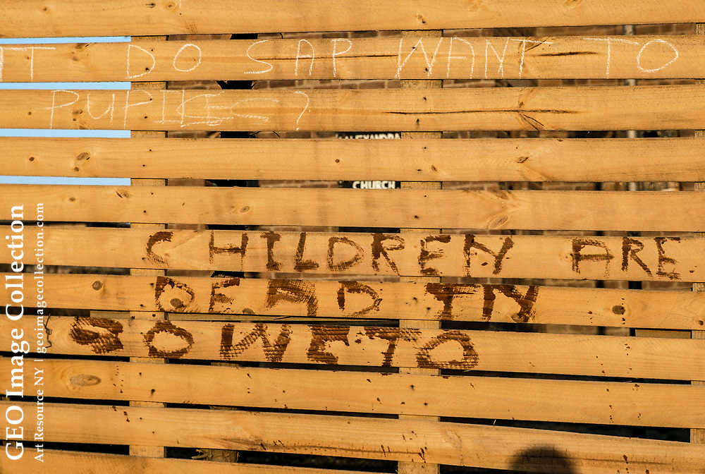 Sad message on a wooden fence after rioting in Soweto.