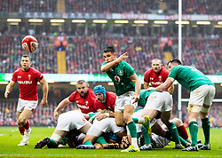 Conor Murray of Ireland gets the ball away<br /> <br /> Photographer Simon King/Replay Images<br /> <br /> Six Nations Round 5 - Wales v Ireland - Saturday 16th March 2019 - Principality Stadium - Cardiff<br /> <br /> World Copyright © Replay Images . All rights reserved. info@replayimages.co.uk - http://replayimages.co.uk