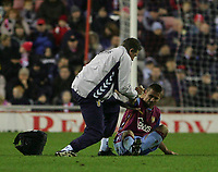 Photo: Andrew Unwin.<br />Sunderland v Aston Villa. The Barclays Premiership.<br />19/11/2005.<br />Aston Villa's Kevin Phillips (R) is helped to his feet by the physio.