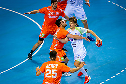 The Dutch handball player Samir Benghanem in action against Jure Dolenec from Slovenia during the European Championship qualifying match on January 6, 2020 in Topsportcentrum Almere