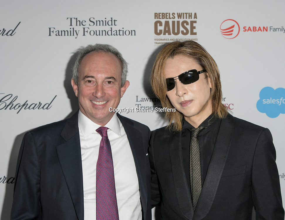 DAVID AGUS (L) and YOSHIKI HAYASHI attend the 'Rebels With A Cause'  benefitting the Lawrence J. Ellison Institute for Transformative Medicine of USC at The Water Garden in Santa Monica, California.