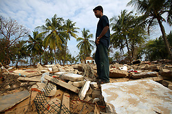 Judeson Britto Moses, who lost his entire immediate family in the tsunami, visits the remains of his home in the destroyed Dutch Bar village, Batticaloa, Sri Lanka, Jan. 16, 2005. Residents of the village spent more than six weeks in a makeshift refugee camp at the local convent recovering from the devastating tsunami that hit the eastern and southern borders of Sri Lanka. They were then moved into another temporary living camp, while awaiting the building of new homes.