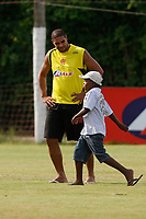 20091201: RIO DE JANEIRO, BRAZIL - Flamengo training session at CT Ninho Urubu training center. Brazilian football star Adriano recovering after burning his foot in a domestic accident. With one round left to the end of the Brazilian League, Flamengo is leading the championship. In picture: Adriano with a young boy. PHOTO: CITYFILES