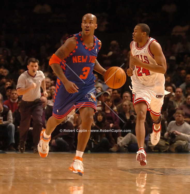 New York's Stephon Marbury drives down the court during the 2nd quarter of the New York Knicks vs Chicago Bulls match-up at Madison Square Garden Friday March 3, 2006. Robert Caplin For The New York Times..
