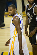 Golden State Warriors forward Kevin Durant (35) looks at the San Antonio Spurs during a time out at Oracle Arena in Oakland, Calif., on October 25, 2016. (Stan Olszewski/Special to S.F. Examiner)