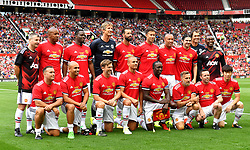 Manchester United players pose for a photograph before kick-off in the legends match at Old Trafford, Manchester.