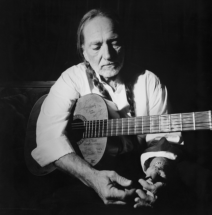 Willie Nelson had gotten rid of his tuxedo jacket by the time he returned to his tour bus following a TV taping. I spent 30 minutes listening to him play. The key moment came after I asked him what song he was working on... That split second of thought turned out to be the perfect moment.