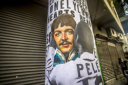 June 18, 2017 - SâO Paulo, São paulo, Brazil - SAO PAULO, BRAZIL - JUNE 18: A wheat-paste piece of street art by artist Luis Bueno Shows soccer player Pelé kissing singer Paul McCartney. Today, June 18, one of the most charismatic and creative beatles, Paul McCartney, turns 75 years old. In October, the birthday party Beatle will perform in four Brazilian cities. It is his seventh passage through the country. Tickets to Porto Alegre and São Paulo are already sold out. Paul will also play in Belo Horizonte and Salvador. (Credit Image: © Cris Faga via ZUMA Wire)