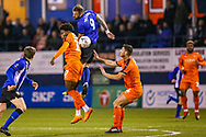 Sheffield Wednesday forward Steven Fletcher (9) and Luton Town midfielder Pelly-Ruddock Mpanzu (17) challenge in the air during the The FA Cup 3rd round replay match between Luton Town and Sheffield Wednesday at Kenilworth Road, Luton, England on 15 January 2019.