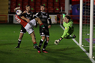 Crawley Town's Tom McGill Walsall's Jake Scrimshaw during the EFL Sky Bet League 2 match between Walsall and Crawley Town at the Banks's Stadium, Walsall, England on 3 November 2020.