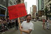 A man representing sex workers in the 2011 Pride Parade on New York's Fifth Avenue with a placard offered Governor Cuomo a freebie for his support in legalizing gay marriage in New York.