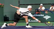 Lleyton Hewitt returns a drop shot while playing Younes El Aynaoui during their fist round match at the Pacific Life open tournament in Indian Wells, CA.  on Tuesday March 11, 2003. Hewitt won the match 4-6,7-5, 6-2.