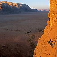 Mountaineer David Roberts rappels off Jebel (Mount) Khaz Ali in Jordan's Wadi Rum, a spectacular part of the Arabian Desert.