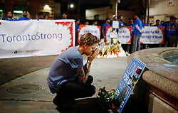 A young man reacts at a vigil remembering the victims of a shooting on Sunday evening on Danforth, Ave. in Toronto, ON, Canada, on Monday, July 23, 2018. Photo by Mark Blinch/CP/ABACAPRESS.COM