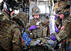© London News Pictures. 11/06/11. AFGHANISTAN. The RAF Regiment's Medical Emergency Response Team (MERT) is made up of two teams based in 'Main Operating Base Bastion', they are responsible for extracting casualties from anywhere within Helmand Province.  The MERT consists of a doctor, an emergency department nurse and two paramedics.  In addition four Royal Air Force Regiment gunners provide armed protection when they land and leave the helicopter to collect the casualty.   Caption must read Alison Baskerville/LNP...