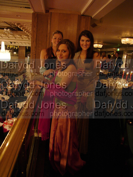 Annabel Reid, ( blue) Arabella Foster ( red)  and Clemmie Carr ( shorter) . White Knights Ball, Grosvenor House Hotel 7 January 2005. ONE TIME USE ONLY - DO NOT ARCHIVE  © Copyright Photograph by Dafydd Jones 66 Stockwell Park Rd. London SW9 0DA Tel 020 7733 0108 www.dafjones.com