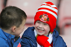 A young Sunderland fan smiles in the stands