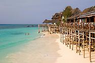 Restaurants on stilts lining the beach at Nungwi, Zanzibar, Tanzania