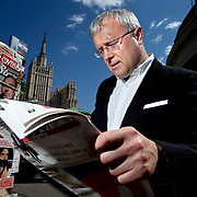 Russian oligarch Alexander Lebedev poses with a copy of the newspaper Novaya Gazeta by a newstand in Moscow. Lebedev is a part-owner of the independent news publication, which employs some of Russia's most courageous journalists including slain reporter Anna Politkovskaya. Lebedev also owns London's Evening Standard newspaper.