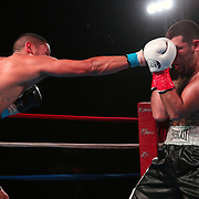 Miguel Cruz of Puerto Rico (L) punches Ali Mammadov of Azerbaijan during the Puerto Rico vs The World boxing event at Orlando Live Events Center on Friday, March 24, 2017 in Casselberry, Florida.  (Alex Menendez via AP)