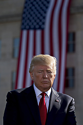 September 11, 2017 - Washington, District of Columbia, U.S. - United States President DONALD J. TRUMP, pauses during a ceremony to commemorate the September 11, 2001 terrorist attacks, at the Pentagon.  (Credit Image: © Andrew Harrer/Pool/CNP via ZUMA Wire)