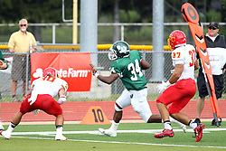 19 September 2015:  Maurice Shoemaker-Gilmore appears trapped by Zach Rathman and Abe Wolfe during an NCAA division 3 football game between the Simpson College Storm and the Illinois Wesleyan Titans in Tucci Stadium on Wilder Field, Bloomington IL