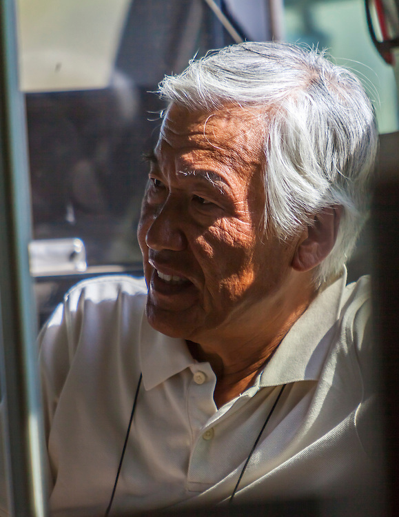 A Japanese photographer rides the bus out to the pylons at the 2012 Reno Air Races.