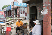 The old markets and small dwellings which will be soon destroyed to make way for the Huge construction and tower blocks in Tongzhou city on the outskirts of Beijing. All the old buildings, villages have been destroyed to make way for the mega cities of today