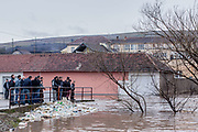 Feb. 6, 2015 - Gjilan, Kosovo - Residents of the village look awakening of the river on the bridge which is floating in the water. A general view shows flooded area in Livoc i Ulet village, near Gjilan, Kosovo, 06 February 2015. Heavy rain and snow caused rivers to flood thousands of hectares of land, homes and many roads across Kosovo's southern corner. Many areas in southern Kosovo are about to remain without water supply. (Credit Image: © Vedat Xhymshiti/ZUMA Wire)