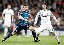 16.03.2011, Stadio Santiago di Bernabeu, Madrid, ESP, UEFA CL, Real Madrid vs Olympique de Lyon, im Bild Real Madrid's Mesut Özil against Olympique de Lyon's Jeremy Toulalan during Champions League match. March 16, 2011. . EXPA Pictures © 2011, PhotoCredit: EXPA/ Alterphotos/ Alvaro Hernandez +++++ ATTENTION - OUT OF SPAIN / ESP +++++