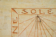 The sun dial on the wall of the building with the carved stone inscription 'Sine Sole Nihil', without the sun there is nothing. Closeup with only 'ne sole' showing. Chateau Mourgues du Gres Grès, Costieres de Nimes, Bouches du Rhone, Provence, France, Europe